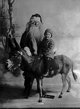Santa hears child's wishes in Oak Park circa 1900